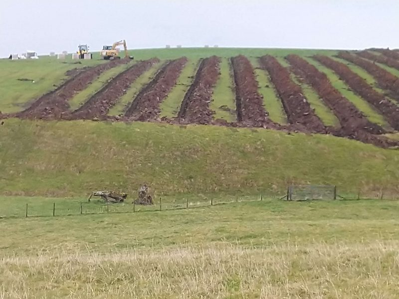 multiple trenches on a hillside for draining pipes